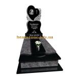 Гранітний пам'ятник на могилу з ангелом і квітами для жінки