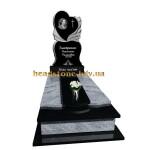 Гранітний пам'ятник на могилу з ангелом і квітами